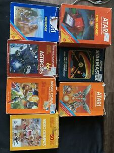 Lot Of 7 Atari 2600 Games With Boxes And Manual. Defender,Asteroids,Star Raiders