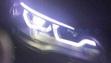 FARI CROMO BMW X5 E70 ANGEL EYES XENON SERIE AFS CON LUCE CURVA 06-10 + MOTORINI