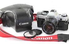 Canon AE-1 Clásico 35mm cámara de cine. FDN 1:1 .8 F = Canon 50mm lente principal y estuche.