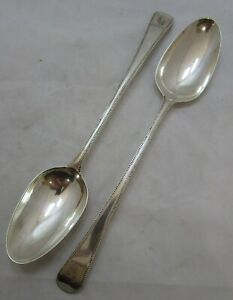 Pair Antique Georgian Sterling silver bead pattern basting spoons, 1780, 163g