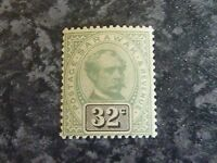 SARAWAK POSTAGE & REVENUE STAMP SG19 GREEN & BLACK 32C VERY LIGHTLY MOUNTED MINT