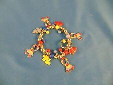 Woman's Puzzle bracelet elastic silver red beads & ribbons puzzle pieces autism