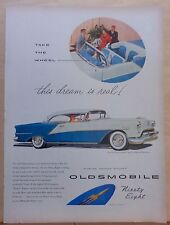 1954 magazine ad for Oldsmobile - Ninety-Eight Deluxe Holiday Coupe, colorful