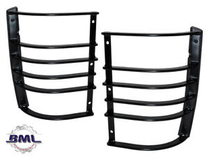 LAND ROVER DISCOVERY 1 LAMP GUARD REAR PAIR. PART - RTC9503AA