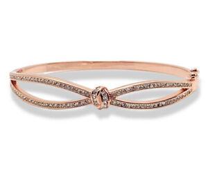 Rose gold finish infinity design created diamond bangle