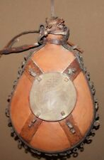 Vintage hand made redware pottery flask with leather ornaments