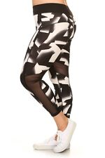 Plus size black/white abstract printed active legging with mesh panels. LY6332-4