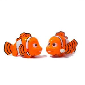 Clockwork Wind Up Clown Fish Fins Swing Wheeled Kids Fun Toy Party Bag Filler