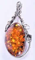 A gorgeous vintage pendant made of amber inserted in lovely silver 925 framework