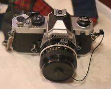Nikon FM 35mm SLR Film Camera Nikkor 50 mm 1:2 lens MD-11 grip