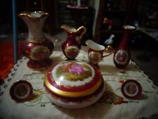7 pieces red and gold limoges in excellent condition.