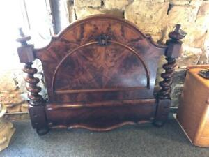 Ornately carved French bed head in flame mahogany veneer