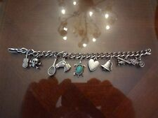 VINTAGE STERLING SILVER CHARM BRACELET WITH 9 STERLING CHARMS--OLD AS DIRT-NICE