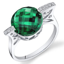 14 Kt White Gold 4.3 cts Emerald and Diamond Ring R61754