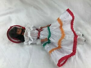 BARBIE - DARK HAIR - WHITE FRILLY DRESS WITH COLOURED TRIM - HAT - BLACK SHOES