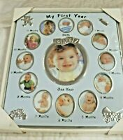 "NEW My First Year Baby Girl Picture Frame Holds 13 Pictures 12"" H by 9 1/2"" W"