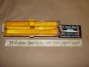 73 Pontiac Grandville LEFT FRONT FENDER TURN SIGNAL PARKING LIGHT LENS AMBER