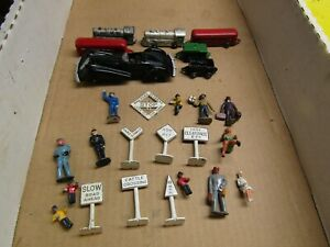 American Flyer S Gauge Cast figures (12), signs ( 7), Manoil Coupe, small trains
