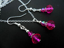 A SILVER PLATED PINK CRYSTAL  NECKLACE AND  EARRING SET. NEW.