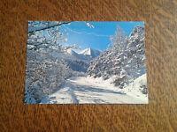 carte postale paysage hivernal route en montagne