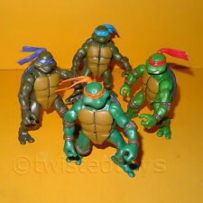 2002 TEENAGE MUTANT NINJA TURTLES (TMNT) LOT 4 ACTION FIGURES DON LEO MIKE RAPH