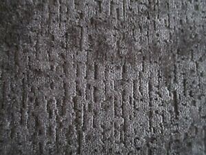 A QUALITY UPHOLSTERY FABRIC IN A SOFT BLACK TEXTURED CHENILLE.