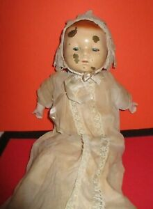 ANTIQUE METAL HEAD DOLL  WITH COMPOSITION ARMS,CLOTH LEGS ORIGINAL CLOTHING