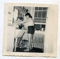1950s  Square b/w snapshot Photo Lady in shorts washing dishes Kitchen   EC22