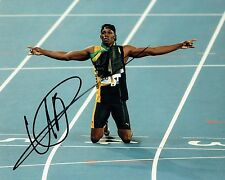 Usain Bolt SIGNED Rio 2016 Olympic Athlete 10x8 Race Photo 2 AFTAL Autograph COA