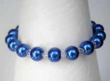 "Deep blue 8mm glass pearl and clear bead bracelet 7.5"" with 1.5"" extender"