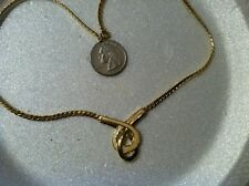 UNMARKED  GOLD NECKLACE    LOOPED  KNOT      20/21