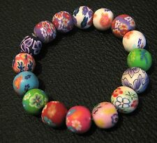 Great elasticated beaded bracelet with pretty floral/abstract design beads