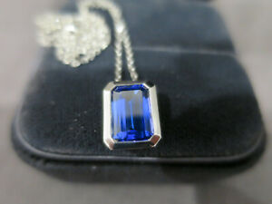 emerald cut blue tanzanite necklace pendant in white gold chain and setting 750
