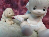 "Precious Moments-#520705 ""BABY'S FIRST PET""-Baby Boy Feeding Bottle To Dog- NIB"