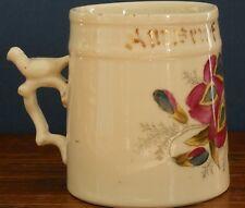 An antique Continental porcelain souvenir tankard bird handle [imperfect]