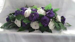Wedding flowers Cadbury Purple & White wedding table flower centrepiece display