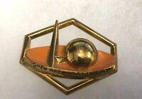 1939-40 New York World's Fair Brass and Orange Enamel Trylon and Perisphere Pin