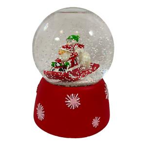 Hallmark Snowglobe Music Box Santa Snowman and Penguin on Sled