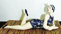 RECLINING BATHING BEAUTY FIGURINE IN NAVY & WHITE FLORAL BATHING SUIT