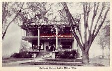 COTTAGE HOTEL, LAKE MILLS, WIS. guests gather on front porch