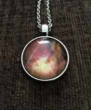 Galaxy Triangle Hipster Nebula Geometric Necklace With A Gold Coloured Chain.