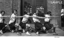 1920's High School Girl Cheerleaders With Onlookers