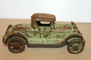 VINTAGE A.C. WILLIAMS GREEN CAST IRON 5 WHEEL ROADSTER