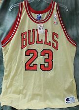 RARE NEVER WORN! CHAMPION SIZE 48 MICHAEL JORDAN GOLD #23 CHICAGO BULLS JERSEY