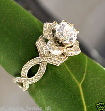 1.99ct round cut solitaire blossom petal Diamond Engagement ring 14ct white gold