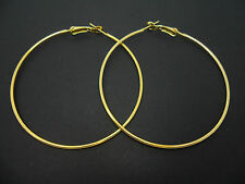 A PAIR OF  GOLD COLOUR LARGE 50MM HOOP  EARRINGS. NEW.