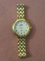 Timex Indiglo Women's Water Resistant CR 1216 Cell Gold Tone