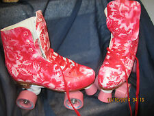 Women Red & White Roller Skates size 7,  heel to toe 9 1/ 2 in. BE DIFFENENT!!!