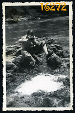 Vintage Photograph, young man takes a picture, photo camera 1940's Hungary
