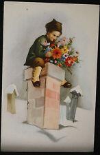 Carte postale fantaisie - Enfant sur une cheminée avec bouquet de fleurs + neige